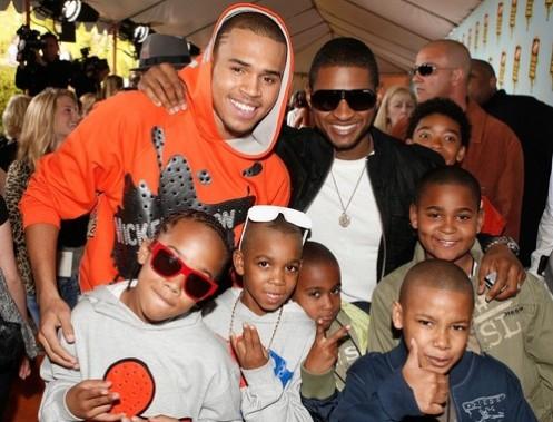 Singer usher Singer Chris brown inn orange  and three of Usher   s    Usher Kids And Wife